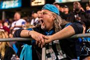 A Carolina Panthers fan yells for his team. The Panthers defeated the New England Patriots 24-20 in a Monday Night Football game at Bank of America Stadium in Charlotte on Nov. 18, 2013.