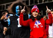 Panthers fans and Patriots fans show their colors.