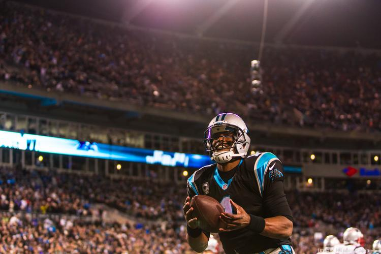 Carolina Panthers quarterback Cam Newton celebrates a fourth-quarter touchdown by Ted Ginn Jr. The Panthers defeated the New England Patriots 24-20 in a Monday Night Football game at Bank of America Stadium.