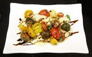 The tomato and Mozzarella salad is a new item offered for sale this season at the newly branded Rivertowne Brewery Hall of Fame Club at PNC Park.
