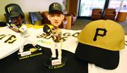 A.J. Burnett and Andrew McCutchen bobbleheads and a replica 1970s-era cap are some of the promotional items scheduled to be handed out to fans attending select games at PNC Park this season.