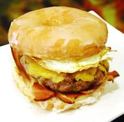 The Brunch Burger, featuring an Angus burger topped with house made bacon, fried egg, cheddar cheese on a glazed donut, is a new item offered for sale this baseball season to patrons of the newly branded Rivertowne Brewery Hall of Fame Club at PNC Park.
