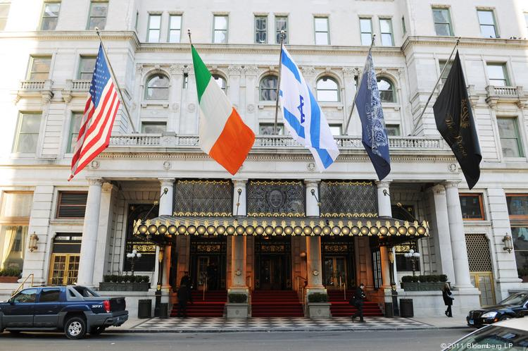 Flags fly outside The Plaza Hotel in New York.