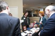 Booth representatives share with guests about their company during the Nonprofit Expo.