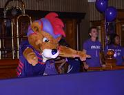 Orlando City mascot Kingston leads the ballroom crowd in a cheer.