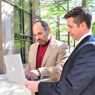 (L-R) The Taurean Corp.'s Jeff Jaime and Senior Project Manager Daniel Isgro look over project specifications.