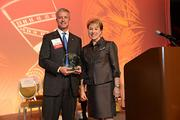 L to R: Forum of Executive Women Advancing Women Company Award Global Winner, EY, represented by Chris Bruner, Managing Partner and Nila Betof, President, The Forum of Executive Women