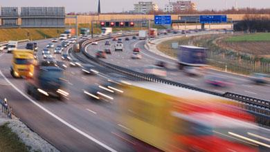 traffic on multiple lane highway at twilight with motion blur