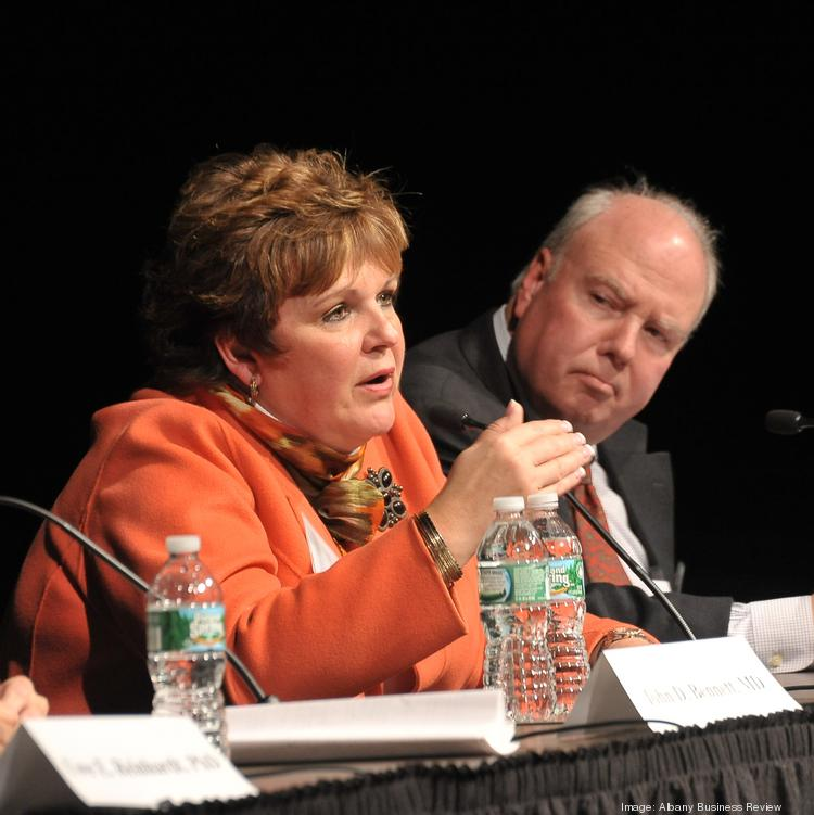 Paula Stopera, president and CEO of CAP COM Federal Credit Union, says her health care premiums have more than doubled in the last seven years. She sees that as a threat to her business, undercutting her company culture. She's pictured here with Dennis Whalen, president, Healthcare Association of New York State (HANYS).