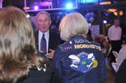 Shinn with his mother-in-law, Janice Turpin, sporting a Hornets jacket