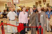 Michael Richey, store director of the Myers Park location, cuts the ribbon to open the new store.