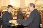 Shoppers sample different foods at the new Harris Teeter in Myers Park.
