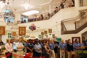 People crowd into the new Myers Park Harris Teeter for a ribbon cutting on Tuesday.
