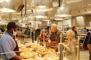 Shoppers check out the pizza bar at the Harris Teeter in Myers Park.