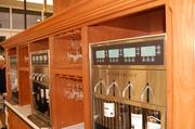 Shoppers at the Myers Park Harris Teeter can buy wine by the glass using this wine station by Napa Technology.