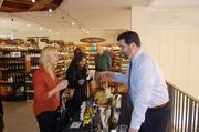 A wine consultant talks to shoppers about various wines during the grand opening of the Myers Park Harris Teeter.