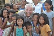 Gordon James enjoys a light moment with kids in the Philippines.