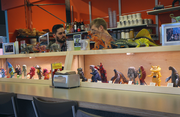 Japanese monster toys on display at Laughing Planet Cafe's Portland State University Location.