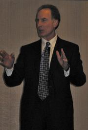 Business futurist Roger Selbert, gave the audience some more-uplifting news about the local economy.