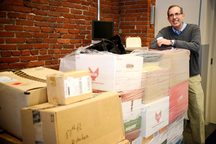 Raymond Buehler, CEO of Schneider Downs & Co., stands among the boxes Oct. 18 as his firm prepared to move from the Strip District to new space at One PPG Place, downtown.