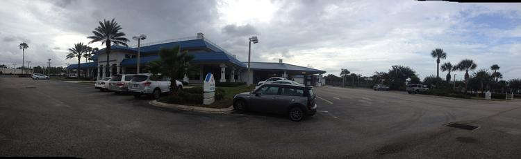 An exterior shot of the old Chevy dealership building at Seminole State College's Altamonte Springs campus