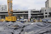 Workers prepare to start construction on the Symphony Honolulu mixed-use condominium project.