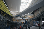 Workers are busy preparing the atrium space.
