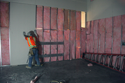 A worker puts up sheet rock in the microscopy lab, the most expensive corner of the project, at $12 million.