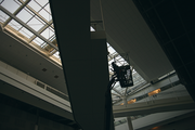 Workers in the central atrium of the building, where nine bridges connect.