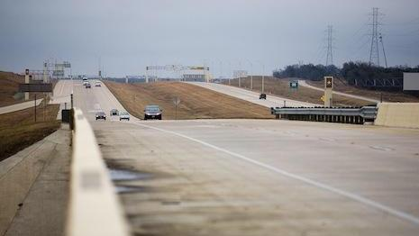 The tollway company that built a section of State Highway 130 is negotiating with several banks in order to refinance much its debt, according to a report by a debt rating agency.