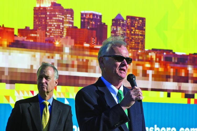 Ed Kitchen, right, co-chair of Opportunity Greensboro, speaks during the announcement of the location for the downtown university campus. Tim Rice, CEO of Cone Health, looks on.