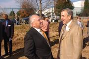 January 2005: Atlanta developer Hal Barry, left, chats with Sam Williams after the groundbreaking ceremonies for  Ivan Allen Jr. Boulevard.