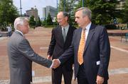 June 2006: Tom Mattia, senior vice president and director of worldwide public affairs and communications of The Coca-Cola Co., from left, greets A.J. Robinson, president of Central Atlanta Progress, and Sam Williams after the press conference to announce the kick offof the Centennial Olympic Decade Celebration.