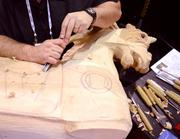 Don Blakley of The Carousel Works carves a horse out of bass wood in the IAAPA exhibitor room.