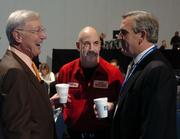 November 2006: Bernie Marcus, co-founder of The Home Depot Inc. and benefactor of the Georgia Aquarium, left, talks with motivational speaker Jeffrey Gitomer  and Sam Williams at the 2006 Atlanta Business Chronicle Business Growth Expo.