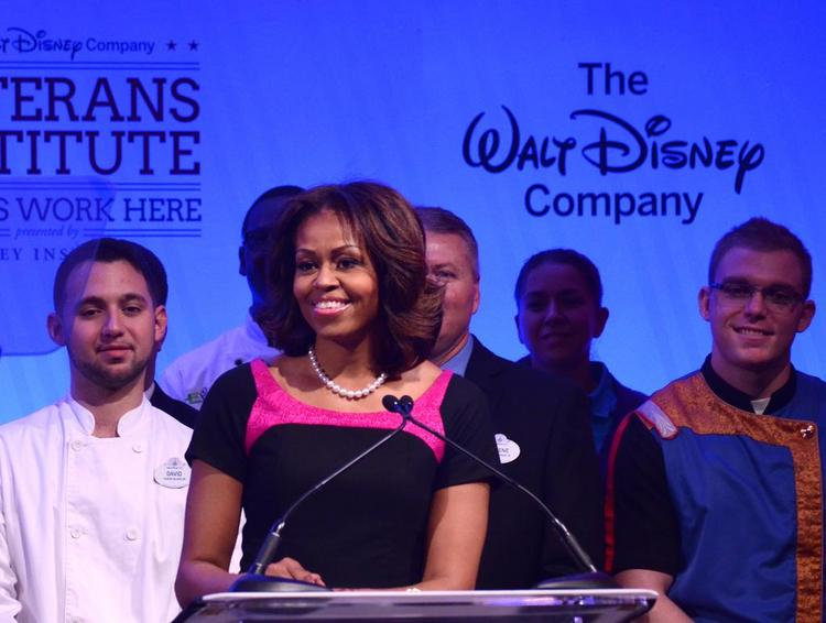 U.S. First Lady Michelle Obama joined Walt Disney World CEO Bob Iger on Nov. 14 to honor veterans' contributions in the armed forces and in the private-sector workforce.