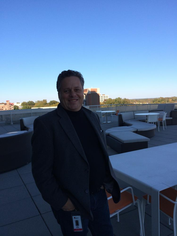 Randy Russell, Red Hat's director of certification, stands on the large outdoor deck, which provides sunny space for employee gatherings, a getaway place for clearing one's head and a fantastic view of downtown Raleigh.