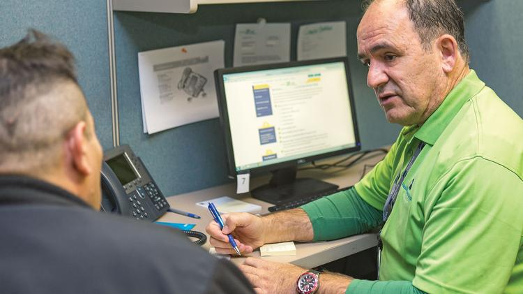 Angelo Solera, right, of HealthCare Access Maryland, helps Pedro Oseas Romero navigate the process of getting insurance through the exchange, which has been plagued with problems since its October rollout.