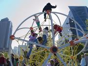 Children take to the modern day jungle gym in the park's extensive children's park.