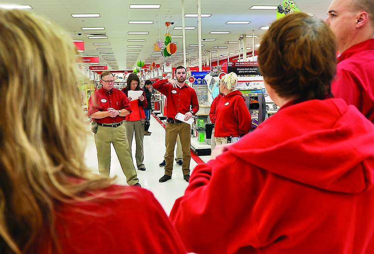 The red-shirted sales team huddles at the Glendale Target.