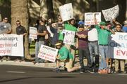 Pro-solar protesters gathered at net metering hearings before the Arizona Corporation Commission. The ACC decided how much solar customers should pay to offset the decrease in energy they use.