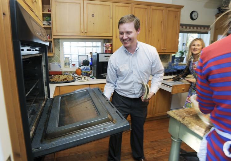 Jeff Steepleton, president of the Galloway Group, volunteers at Judi's House, helping provide dinner for families in need.