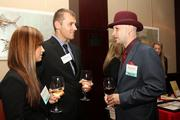 2013 Up & Comers Shannon McIntosh, left, and Alfred Goldberg, right, chat with Vasyl Martyniuk at the event.