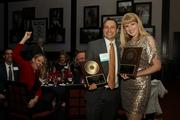2013 Up & Comers David Capece and Jill Witecki with their awards and supporters.