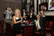 2013 Up & Comer Camille Gomez and her tablemates cheer for a fellow honoree.