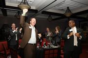 Brian Hanrahan and tablemates cheer for a 2013 Up & Comer.