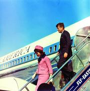 President and Mrs. Kennedy deplane from Air Force One at Love Field in Dallas on Nov. 22, 1963. Photograph by Cecil Stoughton, White House, in the John F. Kennedy Presidential Library and Museum, Boston.