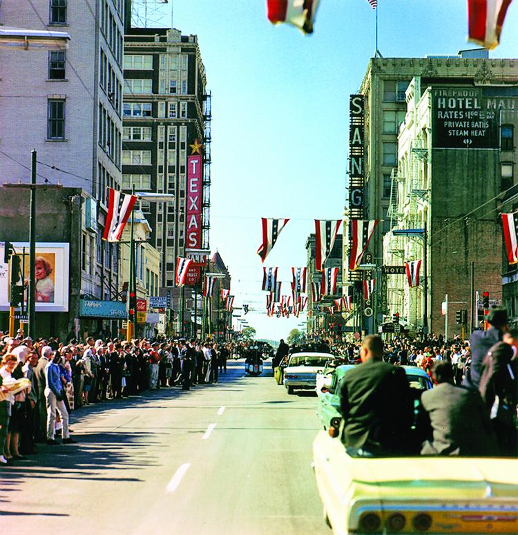 The presidential motorcade on Main Street at Griffin Street in Dallas on Nov. 22, 1963. Photograph by Cecil Stoughton, White House, in the John F. Kennedy Presidential Library and Museum, Boston.
