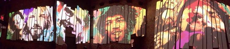 A digital wallpaper of musicians like Jimi Hendrix inside Vale Tudo, the latest bar to open in Fells Point. The wallpaper changes every seven minutes.