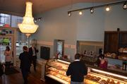 Sasha's Baking Co., one of two new retail tenants in the restored Cosby Hotel building, was busy Thursday, its first day in business.